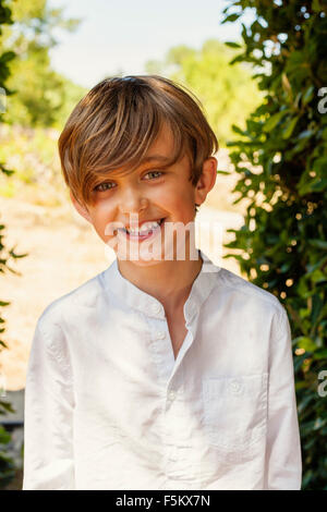 Spain, Menorca, Portrait of smiling boy (6-7) - Stock Photo