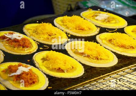 Kind of Thai sweetmeat Khanom Buang (a kind of filled pancake) or Thai Style Crisp Tart.  Khanom bueang (Thai: ขนมเบื้อง), - Stock Photo