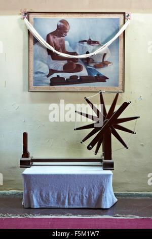 Spinning wheel and painting of mahatma gandhi, rajkot, gujarat, india, asia - rva 190499 - Stock Photo