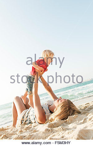 United Arab Emirates, Dubai, Woman with son (12-17 months) on beach - Stock Photo