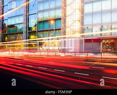 Traffic light trails and office building at dusk, London, UK - Stock Photo