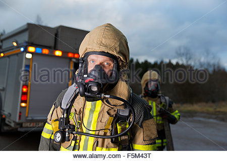 Sweden, Sodermanland, Tumba, Firefighter wearing gas mask - Stock Photo
