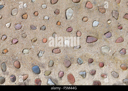 Real stones in cement wall, natural abstract background or texture. - Stock Photo