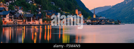 Sunset in Hallstatt, in upper Austria is a village in the Salzkammergut, a region in Austria. - Stock Photo