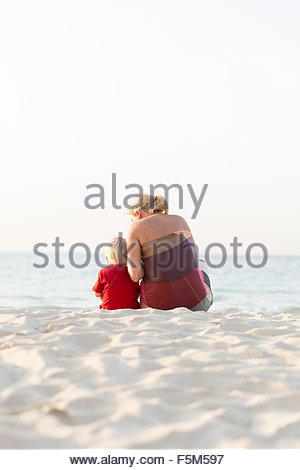 United Arab Emirates, Dubai, Mother with son (2-3) on beach - Stock Photo
