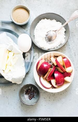 Ingredients prepared for making apple pie, overhead view - Stock Photo