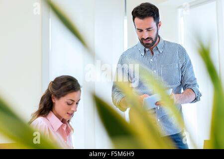 Young businesswoman and man meeting in office - Stock Photo