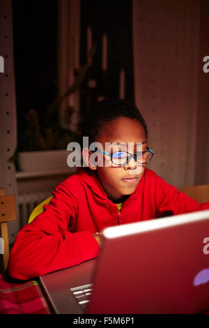 Sweden, Vastra Gotaland, Vastra frolunda, Uppegardsvagen, Boy (10-11) using laptop - Stock Photo