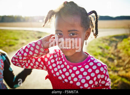 Sweden, Vastra Gotaland, Gullspang, Runnas, Girl (6-7) with painted freckles - Stock Photo