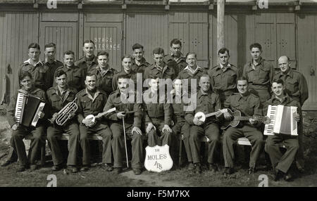 Group of British and Commonwealth prisoners of war with musical instruments in Stalag V111A in Germany. - Stock Photo