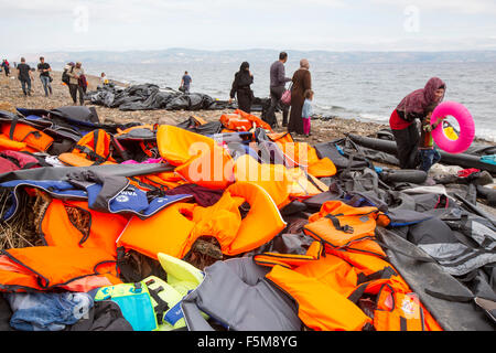 Syrian migrants fleeing the war and escaping to Europe, landing on the Greek island of Lesvos on the north coast - Stock Photo