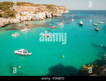 High angle view of yachts anchored in bay at Cala Macarella, Menorca, Spain - Stock Photo