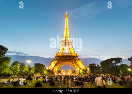 Illuminated Eiffel Tower at dusk, tour Eiffel, Champ de Mars, Paris, Ile-de-France, France - Stock Photo