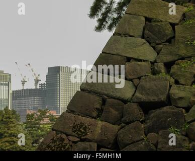 Old and new construction. From the East Gardens, Imperial Palace, Tokyo, Japan - Stock Photo
