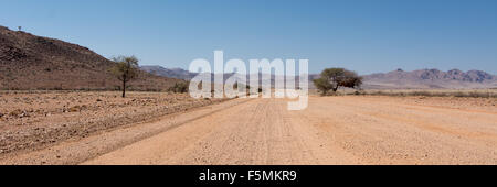 This road is the D707 a special road in Namibia. It leads into the Namib, one of the oldest deserts of this planet. - Stock Photo