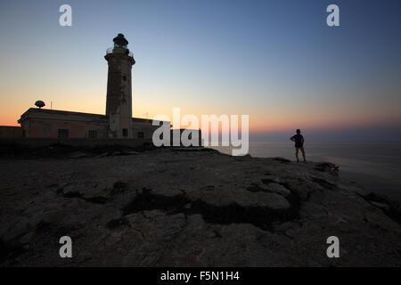Lampedusa lighthouse at sunset, Sicily, Italy - Stock Photo
