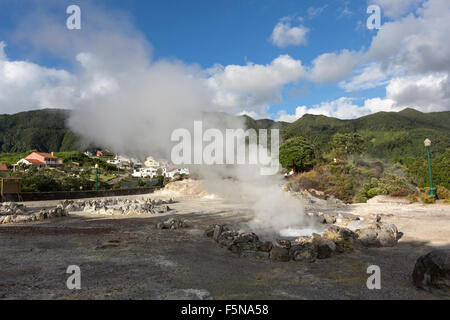 Many geysers, hot-springs and fumaroles scattered in the central village of Furnas, São Miguel, Azores - Stock Photo