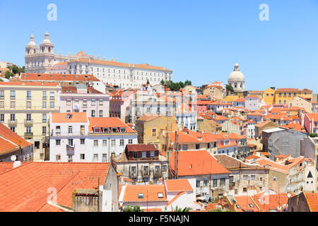 Alfama oldest district scenic view from miradouro. Roofs, Monastery of Sao Vicente de Fora and Church Lisbon Portugal - Stock Photo