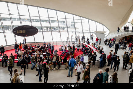 View of crowd at the historic  TWA Flight Center airport terminal at John F. Kennedy International Airport - Stock Photo
