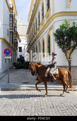 Andalusian man on thoroughbred horse at Tarifa old town, Cadiz province, Andalusia, Spain - Stock Photo