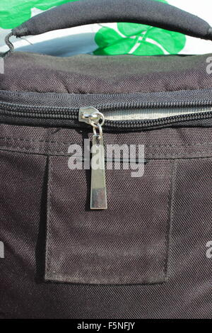 on the bag shows a closeup of zipper closure - Stock Photo