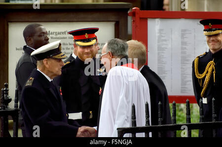 London, Nov 5th 2015. The Duke of Edinburgh and Prince Harry say goodbye to the Very Reverend John R Hall, dean - Stock Photo