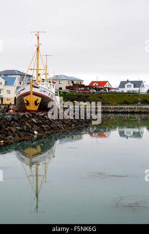 Boat and colorful houses, harbor, Hofn, Iceland - Stock Photo