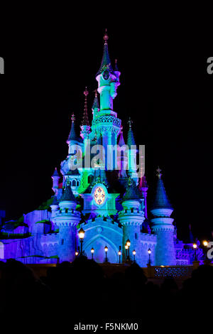 Sleeping Beauty Castle, Fantasyland, Disneyland Paris theme park, Marne-la-Vallée, Île-de-France, France at nightime - Stock Photo