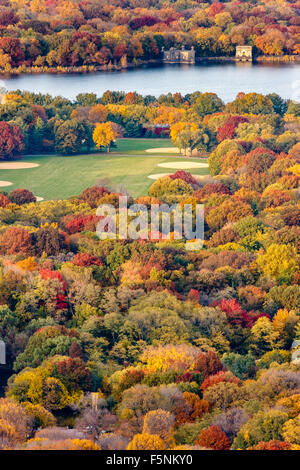 Brilliant fall colors in Central Park. Autumn aerial view of the Great Lawn and Jacqueline Kennedy Onassis Reservoir. New York.