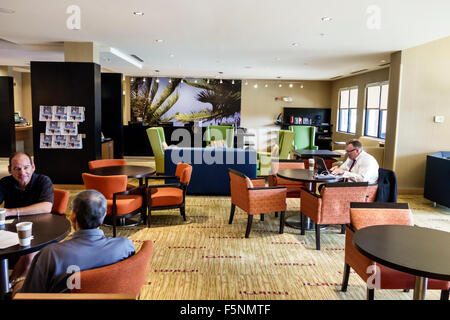 Stuart Florida Courtyard by Marriott hotel motel inside lobby guests furniture - Stock Photo