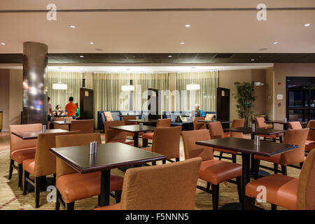 Stuart Florida Courtyard by Marriott hotel motel inside lobby breakfast dining room tables chairs restaurant The - Stock Photo