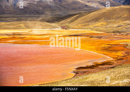 Laguna Miluni is a reservoir fed by glacial meltwater from the Andean peak of Huayna Potosi in the Bolivian Andes. - Stock Photo