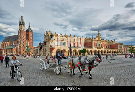 horse-drawn carriage in front of Church of Our Lady Assumed into Heaven or St. Mary's Basilica on market square, - Stock Photo