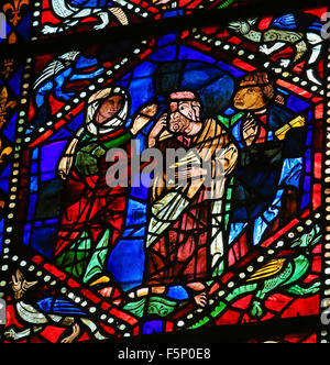 LEON, SPAIN - AUGUST 12, 2014: Stained Glass window depicting Mother Mary blessing a Saint in the Cathedral of Leon - Stock Photo