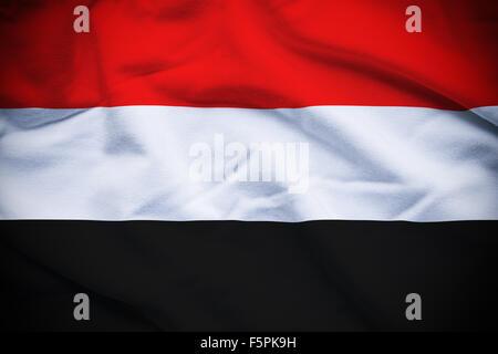Wavy and rippled national flag of Yemen background. - Stock Photo