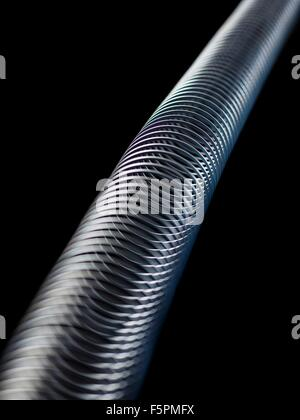 Longitudinal wave in a slinky spring. In longitudinal (or compression) waves the displacement is along the axis - Stock Photo