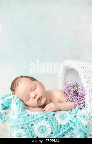 Cute baby sleeping in the carriage - Stock Photo