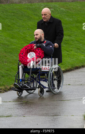 Wheelchair user at Blackpool, Lancashire, UK 8th November, 2015.  Remembrance Sunday Parade. His legs were blown - Stock Photo