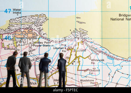 Concept picture of businessmen viewing the Hinkley Point C Reactor program - Stock Photo