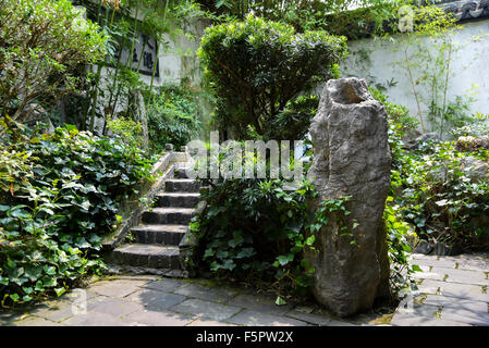 Green plants and rock in Chinese Garden yard of an old traditional house in Hangzhou - Stock Photo