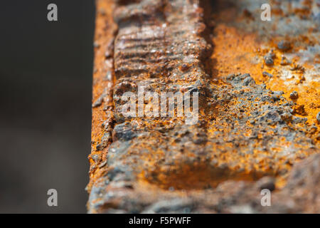 Detail shot of cut rusty steel beams from an old bridge. - Stock Photo