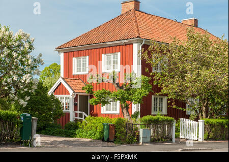 Red city during spring in Norrkoping. This is a picturesque residential area with old red wooden houses in Norrkoping, - Stock Photo