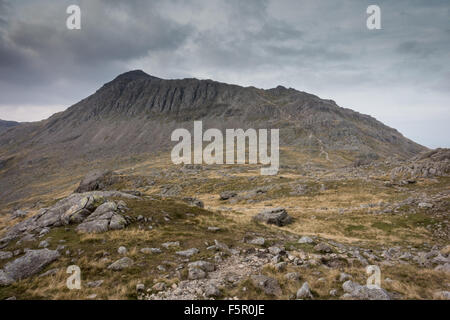 coming down from crinkle crags looking across to Bowfell - Stock Photo