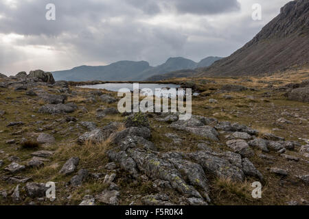 views of the scafell mountain range from three tarns and bowfell - Stock Photo