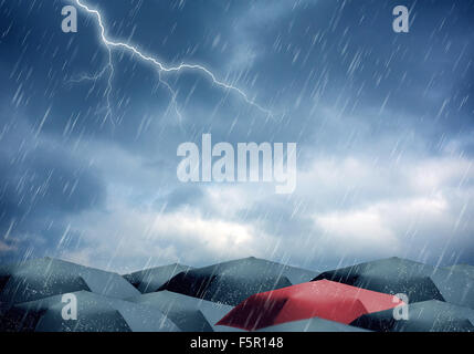 Black and red umbrellas under rain and thunderstorm - Stock Photo