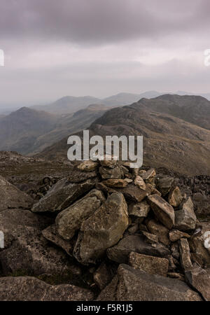 from the summit of Bowfell, looking back across the crinkle crags then to pike o blisco then to Wetherlam then finally - Stock Photo