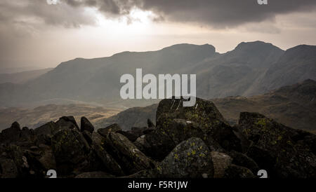 from the summit of Bowfell looking across to the scafell mountain range - Stock Photo