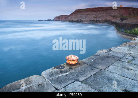 A rusting bollard on the pier at Whitby, North Yorkshire. - Stock Photo