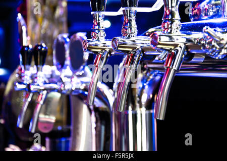 Alcohol conceptual image. Beer dispenser in the bar. - Stock Photo