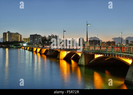 El Condado Lagoon, Dos Hermanos Bridge and skyline, El Condado, San Juan, Puerto Rico - Stock Photo